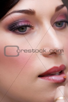 closeup brunette young lady prepare for the event by makeup art