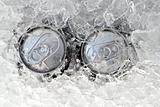 two drink can iced submerged in frost ice
