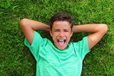 boy laughing teenager laying green grass