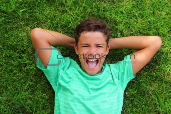 boy laughing teenager laying green grass