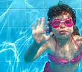 underwater little girl pink bikini blue swimming pool