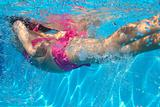 underwater pink bikini little girl swimming in pool