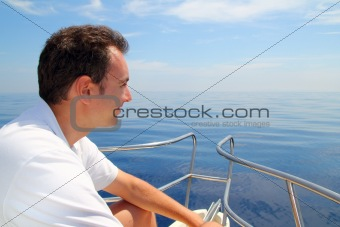 Sailor man sailing boat blue calm ocean water