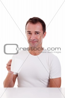 Portrait of a happy man, drinking a drink , isolated on white. Studio shot