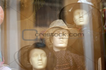 three hats on plastic models