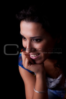 Beautiful Woman Smiling, isolated on black background. Studio shot.
