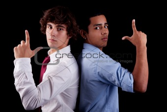 two young man of different colors, back to back, with hand as an police officer with weapon raised, isolated on white, studio shot
