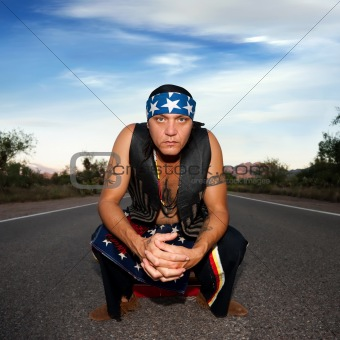 Indigenous man in the middle of a road