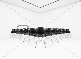 Black Chairs in a white room