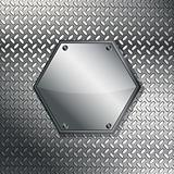 Fluted metal texture with hexagonal label.