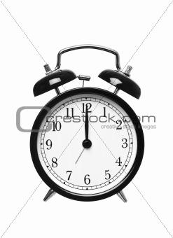 Alarm clock shows Twelwe o`clock