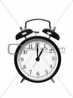 Alarm clock shows one o`clock