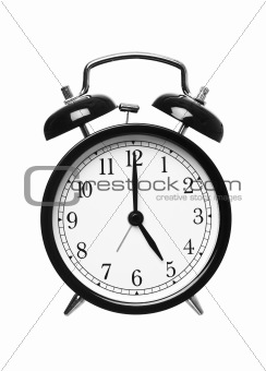 Alarm clock shows five o`clock