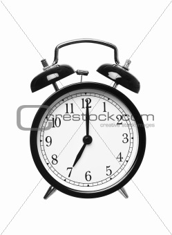 Alarm clock shows seven o`clock