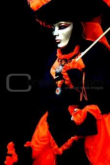 A masked woman on black background