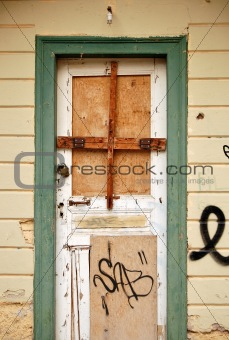 boarded up door
