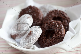 Small bowl with chocolate doughnuts