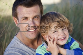 Man & Boy, Father and Son Having Fun At Beach