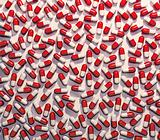 Red and white standard pills medical background