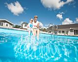Mother and daughter at the swiiming pool