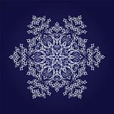 Detailed snowflake on dark blue background