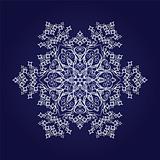 Detailed snowflake on dark blue background