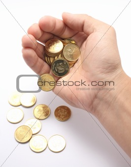 A hand dropping coins