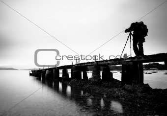 wooden pier with a man