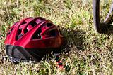 Red helmet lying on the grass