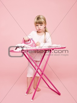 Angry girl ironing