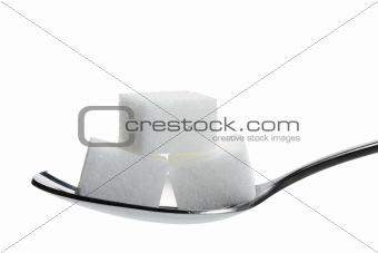 three lump sugar on a spoon