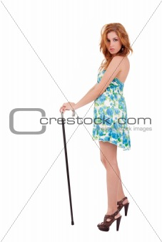 beautiful woman with elegant dress and a cane , isolated on white, studio shot