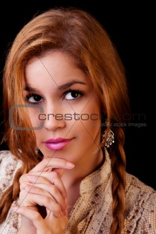 Young pretty women with braids,thinking,  isolated on black, studio shot