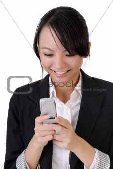 Attractive happy business woman reading SMS