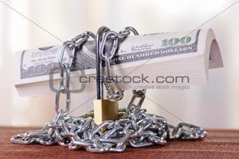 padlock with dollars