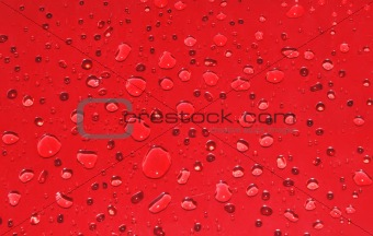 Abstract red background with big and small drops