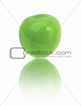 Green apple with dew drops on white background