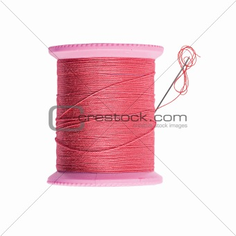 Bright red thread bobbin with needle isolated on white