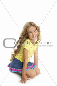 little blond girl smiling portrait on her knees isolated on whit