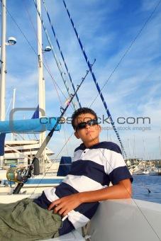 boy relaxed teenager on boat marina summer vacation
