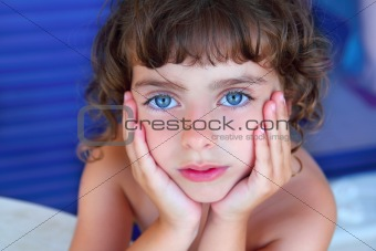 Beautiful blue eyes little girl portrait hands on face