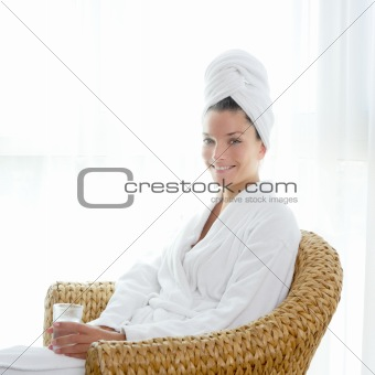 bathrobl woman sitting relaxed hold glass of water