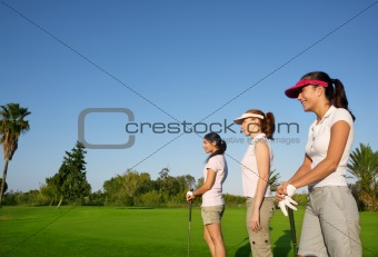 Golf three woman in a row green grass course