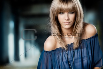 blonde woman on blue background
