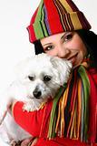 Beautiful woman holding a pet dog