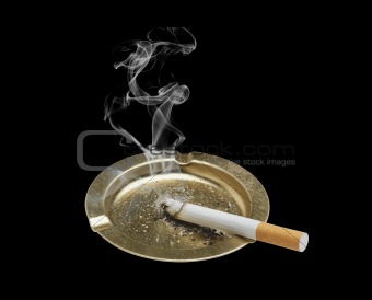 Cigarette and ashtray isolated on black background