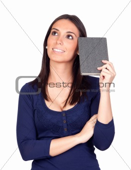 Beautiful girl thinking with a book