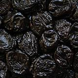 Dry plums or prunes fruit as background
