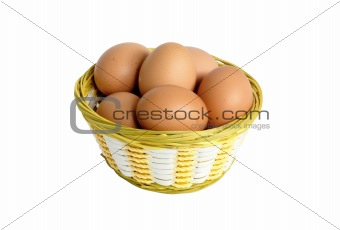 Group of brown hen's eggs in the braided basket isolated on whit
