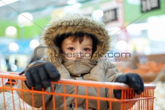 Little boy in shopping cart